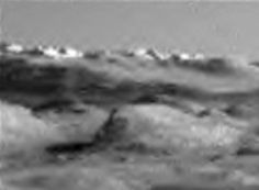 Buildings On Mars,  Video and Photos   This discovery was made by Streetcap1 of Youtube. He found some structures on a hill in one of the Mars Curiosity rover photos. Look at the above photo and pay special attention to the white shiny walls on top of the hill. The walls are white on one side due to reflection and dark shadowy on the other side due to the suns angle.