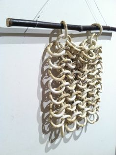 This ceramic chain-maille is mid-fired porcelain with an oxide wash for the bone-like look. it can be hung, layed flat, or moved around into different shapes. The rings aren't fused together so its fun to experiment with placement and to jingle it around in your hands! Ceramic Bone-Maille by Tony Furtado featured on Etsy, $225.00