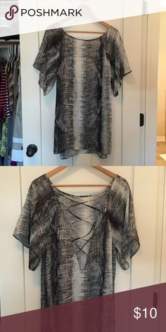 Swimsuit Cover-Up Flowy, black and gray swimsuit coverup with pretty back detail. I loved this coverup on our recent trip to Mexico but currently have too many that I don't wear. Make me an offer! Halogen Swim Coverups