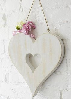 Lovely, white wooden heart with smaller heart cut-out.