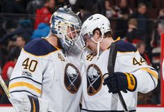 OTTAWA, ON - FEBRUARY 14: Robin Lehner #40 and Nicolas Deslauriers #44 of the Buffalo Sabres celebrate their win over the Ottawa Senators at Canadian Tire Centre on February 14, 2017 in Ottawa, Ontario, Canada. The Sabres won 3-2. (Photo by Andre Ringuette/NHLI via Getty Images)
