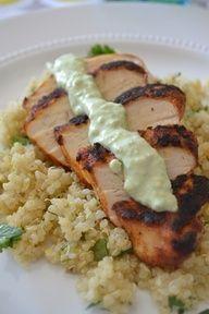 Blackened chicken with cilantro lime quinoa and avocado cream sauce.