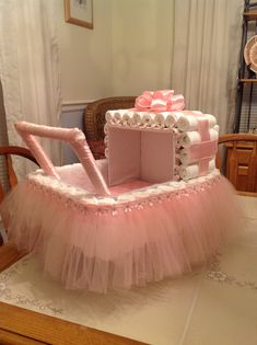 A diaper Ballerina baby carriage for my daughters up coming baby shower.