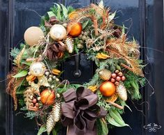 Gold and cream with a hint of orange gives a warm glow to this wreath.