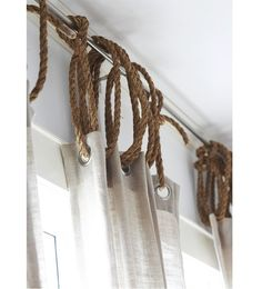 Jute rope is a cheap way to add a rustic/nautical touch to any window dressing. - https://www.facebook.com/different.solutions.page