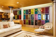 Pretty cool....multi-colored glass used in a sliding door room divider.