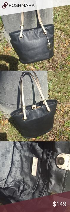 """Michael Kors jet set tote, black 'n tan Gently used tote, black leather w/ beigy tan leather straps, gold accents, multiple pockets inside including one zip pocket, one slit pocket on the outside. Couple light scuffs nothing deep, a little polish would take care of   15"""" wide 10 1/2"""" high 6 1/2"""" base Michael Kors Bags Totes"""
