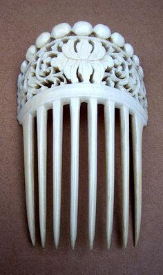 Antique hair comb Chinese export carved ivory lotus design hair accessory.