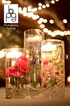 Underwater flowers and floating candles designed by Lana with Fairbanks Florist.