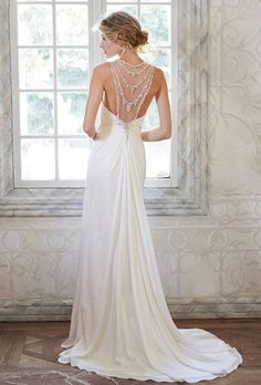 Brides: Maggie Sottero. More details from Maggie SotteroThis fluid Vinita chiffon sheath dress is both vintage inspired and timeless. Stunning Swarovski crystals are draped across an illusion neckline and back. Finished with zipper closure.