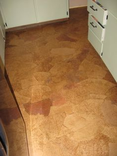 Paper bag flooring - this might be the perfect solution to the laundry room with the slope down!!
