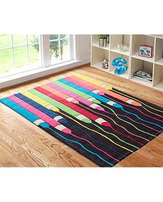 Bright fun and colourful rug for baby's room