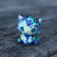 This otherworldly beauty is a galaxy tiger. It has a been painted in a watercolour effect with white stripes and little stars. The eyes have been domed to give them dimension and make them more realistic. You will recieve the exact cub from the picture and I hope you love this little one as much as I do :) It will come glazed and carefully packaged!  -This little cutie is only 3.5cm tall!  ❤❤❤  Follow me on Instagram for news, updates & follower goodies: http://instagram.com/thelittlemew…