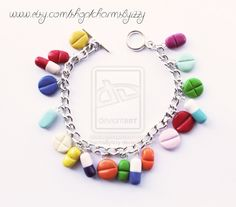 Kitsch Colourful Pill Polymer Clay Charm Bracelet by ~CharmsByIzzy on deviantART