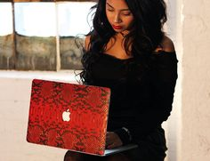 Enhance your laptop with the Red Python MacBook Case by ELEMNT for an effortlessly chic look.