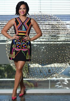 Picture perfect: Demi Lovato attended a press call in Sydney, Australia, on Monday and wore a colourful dress