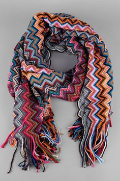 Zee Zig Zag scarf from tobi.  Easy enough to replicate in sc/dc.  Crochet ideas.   http://www.tobi.com/product/42107-joia-zee-zig-zag-scarf?color_id=52608