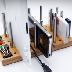Modo, the Modular Desktop Organizer, is a customizable desk accessory that de-clutters your desk. It adds order to chaos by allowing you to stack and hold a range of gadgets and stationery on a small piece of functional bamboo board.