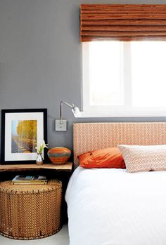 bedroom - I like the wooden shelf, low on the wall, and the big, round basket