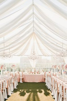 Dreamy tent reception in pink and gold from Onelove Photography