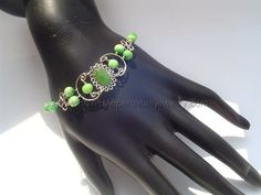 Light-Green Glass & Cat's Eye Beads Bracelets. Click the link to purchase our unique handmade Peruvian jewelry at awesome wholesale prices (includes shipping & insurance!)  Make money with your own online or offline business selling Peruvian Jewelry or save big on beautiful gifts for yourself or that special someone! Click here:  http://www.wholesaleperuvianjewelry.com/