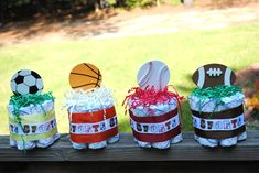 Set of four Small one layer Sports theme Diaper Cakes  - Baby Shower gift /Centerpiece. $24.00, via Etsy.