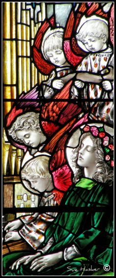 St. Cecilia window by Christopher Whall in St Oswald's Church Ashbourne, Derbyshire. Whall (1849 – 1924) was a leading figure in the Arts and Crafts movement.
