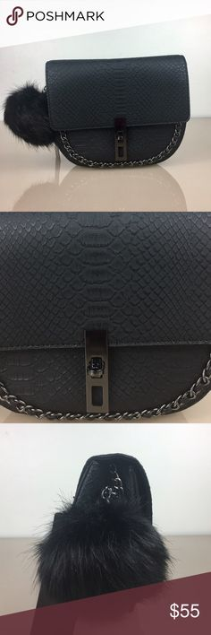💥New💥BCBG Broken Arrow Croc Cross Body bag Attached partial chain shoulder strap. Foldover flap with dual option turn-lock closure. Exterior features front chain embellishment, detachable pompom detail, and textured detail. Interior features 1 zip wall pocket. Approx. 6 H x 8 W x 3 D. Approx. 23 strap drop. Imported BCBG Bags Crossbody Bags