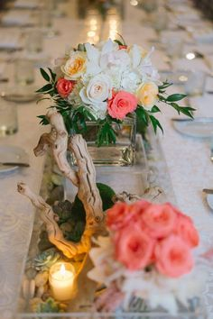 CD Florals Centerpiece: Organic decor made of Italian Ruscus, white Cymbidium Orchids, coral & blush Roses, River stones and drift wood branches.
