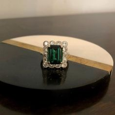 A sensational 1930s green Tourmaline and Diamond Ring. In store now.