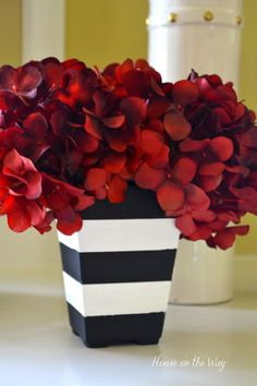 Can't you imagine these with plump orange mums - or pumpkins on top?! Black & White Striped Planters from www.houseontheway.com