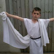 Photo showing a boy in a make and do Ancient Roman tunic and toga.