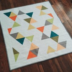 Modern Multi Colored Triangle Quilt by radandhappy on Etsy https://www.etsy.com/listing/232187945/modern-multi-colored-triangle-quilt