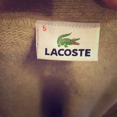 """Lacoste tan grandpa sweater Lacoste oversized """"grandpa"""" sweater or cardie.  Does have some pilling, but easy to remove. Size 5 but would need to look up to know what US size that is. Please let me know if you have any questions. Lacoste Sweaters"""
