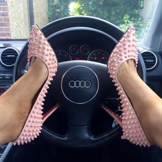 Is it bad that I'm most offended by her loubotins on that Audi?...I mean, respect it!