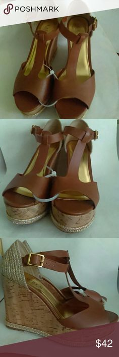 """Lauren Ralph Lauren Sheila Wedge Espadrille Sandal New Lauren Ralph Lauren """"Sheila"""" Espadrille Wedge Sandals. Size 8 (medium), New Without Box, cork wedge, platform 1.75"""", adjustable strap, buckle fastening, polo tan soft burnished calf color, leather top, synthetic sole. T-strap construction. Nicole Shoes Espadrilles"""