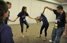 Students race to pass a hula hoop around each other while holding hands as they play cooperative games while participating in the Building Leaders And Strong Tomorrows Youth Group Games, Team Games, Youth Activities, Team Building Activities, Activity Games, Family Games, Fun Games, Games For Kids, Youth Groups