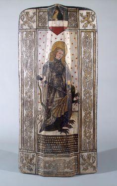 Figure sur le pavois une peinture de st georges terrassant le dragon. Aux quatre coins figure un lion héraldique avec la queue fourchée (armes de Bohême) et les armoiries de la ville d'Enns (actuelle Autriche). On suppose que le bouclier date de 1437 quand le duc Albert V d'Autriche hérite de la couronne de Bohême.  Lieu de fabrication : Bohême. Date : entre 1430 et 1440. Matériaux : bois, fer, huile sur toile (lin). Hauteur : 143cm. Musée de l'hermitage. Z.O. 6090.