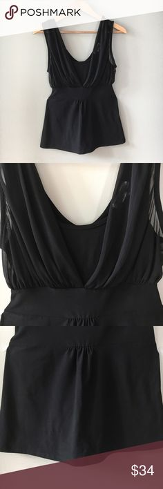 """WHBM Sleeveless Blouse White House Black Market Sleeveless blouse in solid black  Chiffon overlay on bust Ties in back for hourglass silhouette  CARE: Dry clean only.  MATERIALS: 92% polyester, 8% spandex SIZE: Medium MEASUREMENTS: Approximately 26"""" LENGTH (high point shoulder to hem)  17"""" BUST (armpit to armpit)  Excellent condition. Only worn once. White House Black Market Tops Blouses"""