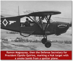 Ramon Magsaysay, then the Defense Secretary for President Elpidio Quirino, marking a Huk target with a smoke bomb from a spotter plane