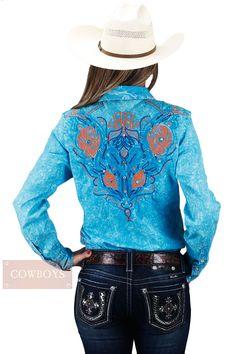 Camisa feminina ROAR cor Azul e Tribal   Camisa roar, feminina, importada, tecido 98% algodão e 2% strech, na cor azul, tecido estampado no interior da gola e punhos, desenho tribal no peito e nas costas na cores azul, laranja e azul turquesa, detalhes em strass, fechamento em botão de pressão. Uma camisa para cowgirls de personalidade e bom gosto, que buscam um look diferenciado e cheio de estilo tanto no dia a dia, em competições ou para ir a uma festa.
