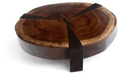 Bolacha Star Coffee Table - $5,600.00 [ Visit Store » ]  The natural rustic moods in the Bolacha Star Coffee Table create casual sophistication and timeless elegance. The age of the wood heightens the interest of the piece with visible rings in the tree cross-section tabletop. Three dark-stained wood legs split the table top into three sections of rich wood, adding angular depth and a modern touch to the rugged piece. Made from a beautiful reclaimed raw edge wood slab, the coffee table is a…