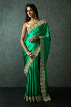 Nothing brings out elegance than a grand green saree!