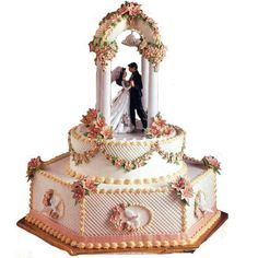 Love's Shelter Cake - A pretty little chapel is the perfect setting for this ornate cake design. Lily, forget-me-nots and drop flowers add an aura of romance.
