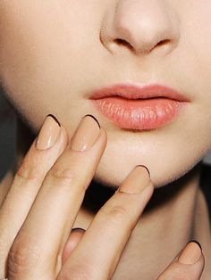 Simple and chic manicure idea of the day: pin-thin black tips on a nude nail.