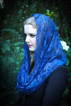 In an ultra fine and light French lace, this veil features a finely scalloped face-framing edge. This is a couture-quality fabric, royal blue French lace. Good coverage, and it is truly a timeless classic. Measures approximately 46X20 inches. Please convo us with any questions; we ship