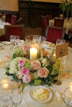 Candlelit Hurricane Lamps were surrounded by a luscious wreath of fresh fragrant blooms Elegant Wedding, Floral Wedding, Wedding Flowers, Wedding Day, Trendy Wedding, Candle Centerpieces, Wedding Centerpieces, Vases, Wedding Table Decorations