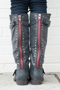 A crisp red zipper, silver studs and buckles galore...when it comes to boots, it's all in the details ladies! This pair from Madden Girl is sure to make you stand out.