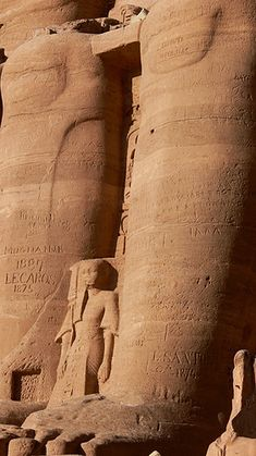 Colossus statue of Ramesses II. Abu Simbel temple, Nubia, Egypt. Some carvings that are not Egyptian can be seen :(
