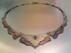 "Necklace | Melody Armstrong. ""Amasia"". Sterling silver, patina, rhodolite garnet"